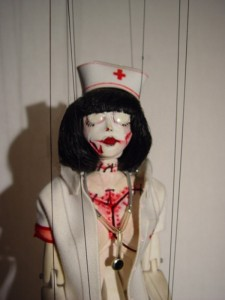 I'm lusting after this zombie nurse marrionette by Devon Ryan